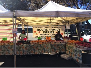 Rojas Family Farm booth at the farmers' market
